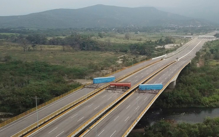 The blockade, made up of a fuel tanker, cargo trailers and makeshift fencing, across the Tienditas International Bridge