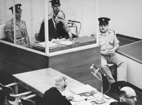 Eichmann taking notes at his trial in 1961