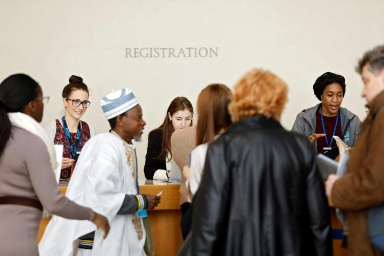 Five delegates registering at the CSW62