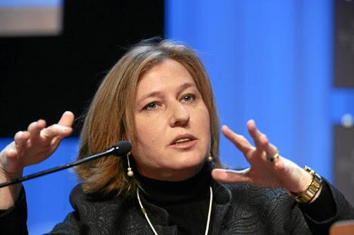 Tzipi Livni talking into a microphone